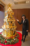 December 4, 2012, Tokyo, Japan - An employee of Japan jeweller Ginza Tanaka, which specializes in gold accessories, showcases their 2.4 meter high gold Christmas Tree in collaboration with Walt Disney Japan in commemoration of Walt Disney's 110th anniversary. The tree is made of 88 pounds of gold which consists of 50 popular Disney characters. The selling price is 350 million Japanese yen (approximately 4.2 million US dollars). The Christmas tree will be displayed at the Ginza Tanaka store until December 25. (Photo by Christopher Jue/Nippon News)