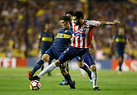 "BUENOS AIRES - ARGENTINA - 04 - 04 - 2018: Cristian Espinoza (Izq.) jugador de Boca Juniors disputa el balón con Jonathan Avila (Der.) jugador de Atletico Junior, durante partido de la fase de grupos, grupo H, fecha 2, entre Boca Juniors (ARG) y Atletico Junior (Col) por la Copa Conmebol Libertadores 2018, jugado en el estadio Alberto J. Armando ""La Bombonera""  de la ciudad Ciudad Autónoma de Buenos Aires. / Cristian Espinoza (L) player of Boca Juniors vies for the ball with Jonathan Avila (R) player of Atletico Junior, during a match of the groups phase, group H, of the 2nd date between Boca Juniors (ARG) and Atletico Junior (Col), for the Copa Conmebol Libertadores 2018 at the Alberto J. Armando ""La Bombonera"" Stadium in Ciudad Autónoma de Buenos Aires. Photo: VizzorImage / Javier Garcia Martino / Photogamma / Cont."