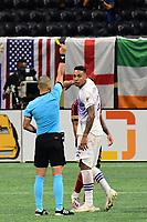 ATLANTA, GA - AUGUST 29: Referee Nima Saghafi issues a yellow card caution to Antonio Carlos #25 of Orlando City during a game between Orlando City SC and Atlanta United FC at Marecedes-Benz Stadium on August 29, 2020 in Atlanta, Georgia.