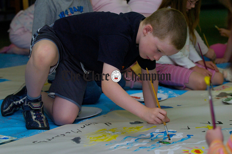 Finn Mc Carthy is engrossed in his work during the Summer activities for Children at the de Valera Library, Ennis. Photograph by John Kelly.