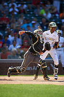 Cooper Johnson (25) of Carmel Catholic High School in Mundelein, Illinois throws down to second as Delvin Perez (1) looks on during the Under Armour All-American Game on August 15, 2015 at Wrigley Field in Chicago, Illinois. (Mike Janes/Four Seam Images)