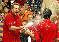 Captain Rosset sprays the champagne in the face of Krachtovil