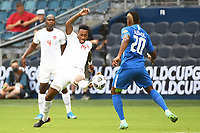KANSASCITY, KS - JULY 11: Mark-Anthony Kaye #14 of Canada stretches for the ball during a game between Canada and Martinique at Children's Mercy Park on July 11, 2021 in KansasCity, Kansas.