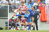 Clarence Goodson (21) of the USMNT goes against Rodolfo Zelaya (11) of El Salvador.  The USMNT defeated El Salvador 5-1 at the quaterfinal game of the Concacaf Gold Cup, M&T Stadium, Sunday July 21 , 2013.