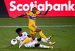 Luis Quinones of Tigres UANL (MEX) fights for the ball against Maylor Nunez of CD Olimpia (HON) during their CONCACAF Champions League Semi Finals match at the Orlando's Exploria Stadium on 19 December 2020, in Florida, USA. Photo by Victor Fraile / Power Sport Images
