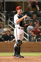 Salt River Rafters catcher/infielder Peter O'Brien (34) during an Arizona Fall League game against the Scottsdale Scorpions on October 7, 2014 at Salt River Fields at Talking Stick in Scottsdale, Arizona.  Scottsdale defeated Salt River 7-4.  (Mike Janes/Four Seam Images)
