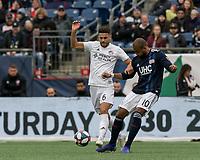 Foxborough, Massachusetts - March 24, 2019: First half action. In a Major League Soccer (MLS) match, New England Revolution (blue/white) vs FC Cincinnati (white), at Gillette Stadium.