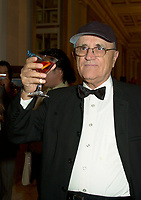 Serge Losique, President and founder of the  Montreal World Film Festival hold a martini during the closing reception at the Windsor, september 2nd 2002 in Montreal, Canada<br /> <br /> The 2003 Montreal World Film  Festival will be held at the same date as the Toronto Festival of Festival.<br /> <br /> <br />  File Photo Agence Quebec Presse - Pierre Roussel