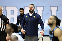 CHAPEL HILL, NC - FEBRUARY 24: Head coach Steve Wojciechowski of Marquette yells instructions to his team during a game between Marquette and North Carolina at Dean E. Smith Center on February 24, 2021 in Chapel Hill, North Carolina.