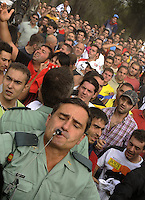 Spanish policemen try to hold back the crowd after a polemic during the bull of the plain 'Toro de la Vega' festival, on September 15, 2009 in Tordesillas. The festival is one of the oldest in Spain with roots dating back to the fifteenth century. The bull has to be enticed across the river from the village to the plain 'Vega' before it can be killed to honour the 'Virgen de la Pena'.   © Pedro ARMESTRE.
