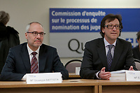 Giuseppe Battista, left, and Eric Down listen as commissioner Michel Bastarache unveils the report of his inquiry in the appointment of judges, commonly know as the Commission Bastarache, Wednesday January 19, 2011.<br /> <br /> PHOTO :  Francis Vachon - Agence Quebec Presse