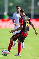 LAKE BUENA VISTA, FL - JULY 16: Edgar Castillo #19 of Atlanta United dribbles the ball during a game between FC Cincinnati and Atlanta United FC at Wide World of Sports on July 16, 2020 in Lake Buena Vista, Florida.