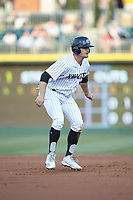 Adam Engel (11) of the Charlotte Knights takes his lead off of second base against the Rochester Red Wings at BB&T BallPark on May 14, 2019 in Charlotte, North Carolina. The Knights defeated the Red Wings 13-7. (Brian Westerholt/Four Seam Images)