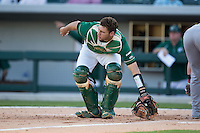 Charlotte 49ers catcher Nick Daddio (20) holds on to the baseball after making a play at the plate against the North Carolina State Wolfpack at BB&T Ballpark on March 31, 2015 in Charlotte, North Carolina.  The Wolfpack defeated the 49ers 10-6.  (Brian Westerholt/Four Seam Images)