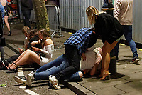 Pictured: Men play fight in Swansea. Tuesday 31 December 2019 to Wednesday 01 January 2020<br /> Re: Revellers on a night out for New Year's Eve in Wind Street, Swansea, Wales, UK.