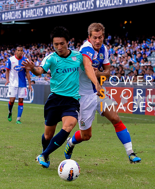 Morten Gamst Pedersen of Blackburn Rovers and Chu Siu Kei of Kitchee FC compete for the ball during the Asia Trophy pre-season friendly match at the Hong Kong Stadium on July 30, 2011 in So Kon Po, Hong Kong. Photo by Victor Fraile / The Power of Sport Images