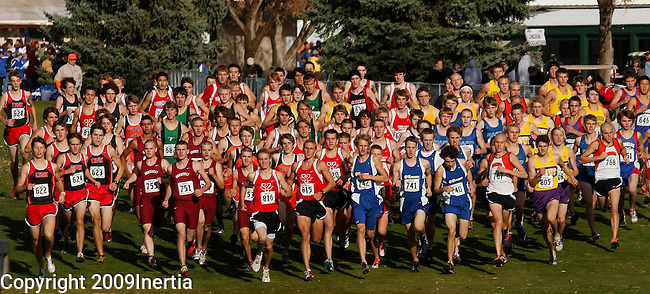 RAPID CITY, SD -- OCTOBER 24, 2009 -- Class AA boys runners get started after a thunderstorm at the 2009 South Dakota State High School Cross Country Meet Saturday in Rapid City. (Photo by Dick Carlson/Inertia)