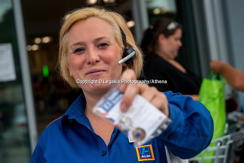 Thursday  21 July 2016<br /> Pictured: Sales assistant emma hands out freebies outside  the newly re-opened store  Re: ALDI Haverfordwest Grand Re-opening