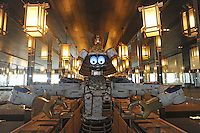 Samurai robot waiter in the Hajime Restaurant, out-skirts of Bangkok, Thailand. Hajime is a Japanese restaurant in Thailand, has samurai style robot serving food to the diners and even do a dance session to entertain guests. This robot are made in Japan and costed about 86,600,000 yen (1,063,717USD). Customers order food from touch panel and Samurai robot will bring ordered food to their table.<br />