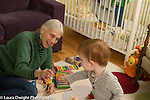 20 month old toddler boy with grandmother playing with toy vehicles and cars, child care, she takes care of her grandchildren twice a week