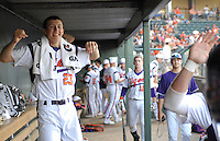 Starting pitcher Daniel Gossett (23) of the Clemson Tigers cheers his teammates from the dugout in a game against the Elon College Phoenix on March 21, 2012, at Fluor Field at the West End in Greenville, South Carolina. Clemson's 4-2 win was Gossett's first college win and head coach Jack Leggett's 1,200th career win.