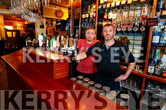 Patrick and Johnny McCarthy behind the bar of Jack Mac's pub in Ashe Street on Wednesday.