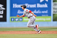Lakewood BlueClaws center fielder Mickey Moniak (22) runs to third base during a game against the Beer City Tourists at McCormick Field on June 1, 2017 in Asheville, North Carolina. The Tourists defeated the BlueClaws 8-5. (Tony Farlow/Four Seam Images)