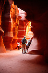 Antelope Canyon is a slot canyon in the American Southwest. It is located on Navajo land near Page, Arizona. Antelope Canyon includes two separate, photogenic slot canyon sections, referred to individually as Upper Antelope Canyon or The Crack; and Lower Antelope Canyon or The Corkscrew.[1]