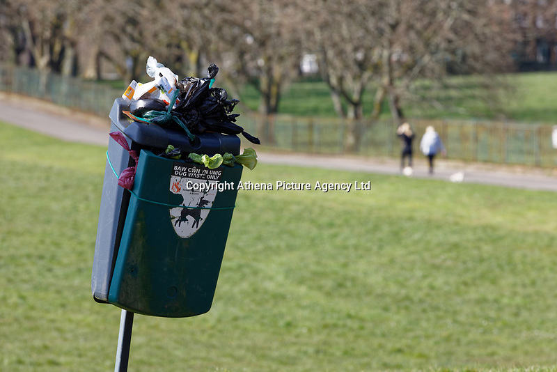 Pictured: An over-filled dog waste bin from too many people walking their dogs in Singleton Park, Swansea, Wales, UK. Friday 27 March 2020<br /> Re: Covid-19 Coronavirus pandemic, UK.