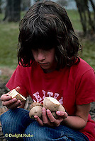 HS05-005z  Potato - child planting potato, Kennebec variety