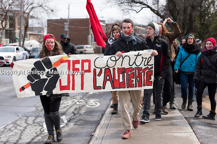 Montreal,CANADA, April 2, 1015.<br /> <br /> Students from Joseph-Francois-Perrault High school protest outside their school before joining<br /> Thousands of people including unions and students protesting  the Quebec government's austerity measures in Montreal Thursday april 2nd.<br /> <br /> <br /> PHOTO : Philippe Manh Nguyen - Quebec Presse