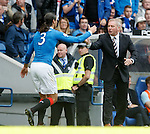 Bilel Mohsni takes the congratulations from manager Ally McCoist after scoring the third goal for Rangers