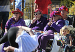 Red Hats, from left, Norma Sumeri, Evie Hahn and MaryLou Pawley watch dancers in the 79th Nevada Day parade in Carson City, Nev., on Saturday, Oct. 28, 2017. <br />