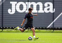 Jack Cork crosses the ball during the Swansea City FC Training at Fairwood Training Ground on September 8, 2016 in Swansea, Wales.