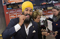 NDP leader Jagmeet Singh eats a cheese curd as he visits Alma in the riding of Lac St-Jean on October 10, 2017.<br /> <br /> PHOTO :  Francis Vachon - Agence Quebec Presse
