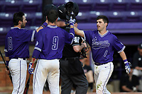 Second baseman Sims Griffith (1) of the Furman Paladins is congratulated by Jake Crawford (19) and Jason Costa (9) after hitting a home run in game two of a doubleheader against the Harvard Crimson on Friday, March 16, 2018, at Latham Baseball Stadium on the Furman University campus in Greenville, South Carolina. Furman won, 7-6. (Tom Priddy/Four Seam Images)