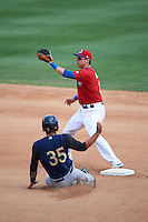 Buffalo Bisons second baseman Andy Burns (8) waits for a throw as Gary Sanchez (35) steals second during a game against the Scranton/Wilkes-Barre RailRiders on July 2, 2016 at Coca-Cola Field in Buffalo, New York.  Scranton defeated Buffalo 5-1.  (Mike Janes/Four Seam Images)