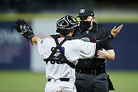 Kannapolis Cannon Ballers catcher Daniel Millwee (13) argues a call with home plate umpire Jacob McConnell during the game against the Down East Wood Ducks at Atrium Health Ballpark on May 5, 2021 in Kannapolis, North Carolina. (Brian Westerholt/Four Seam Images)