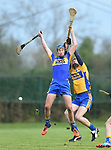 Stephen Kelly of  Newmarket  in action against Paidi Fitzpatrick of  Sixmilebridge during their Clare Champion Cup final at Clonlara. Photograph by John Kelly.