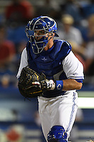 Dunedin Blue Jays catcher Mike Reeves (23) chases a runner back to third before tagging them out during a game against the Clearwater Threshers on April 10, 2015 at Florida Auto Exchange Stadium in Dunedin, Florida.  Clearwater defeated Dunedin 2-0.  (Mike Janes/Four Seam Images)