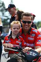 Aug. 4, 2013; Kent, WA, USA: NHRA funny car driver Bob Tasca III with his son during the Northwest Nationals at Pacific Raceways. Mandatory Credit: Mark J. Rebilas-USA TODAY Sports