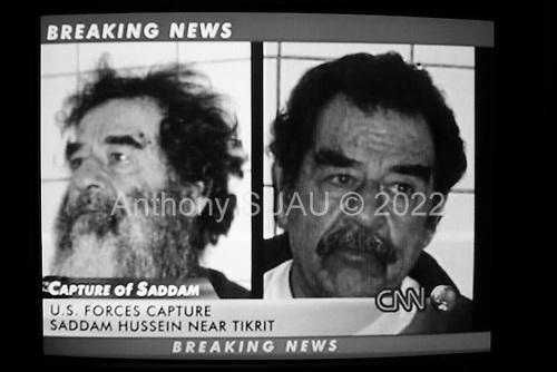Paris, France.December 14, 2004..TV images of the capture of Saddam Hussein.
