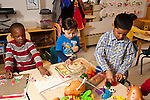Education Preschool 3-4 year olds three boys playing separately with different table toys