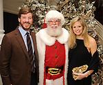 From left: Sarah Covington, Santa Claus and Travis Covington at the M.D. Anderson Santa's Elves party Thursday Dec. 07,2017. (Dave Rossman Photo)