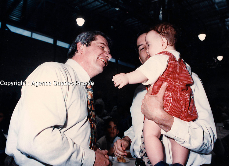 Montreal (Qc) CANADA - May 17 1998<br /> -File Photo -<br /> <br /> Jean Dore , Montreal Mayor, RCM Leader  (L) and a baby.<br /> <br /> PHOTO :  Agence Quebec Presse