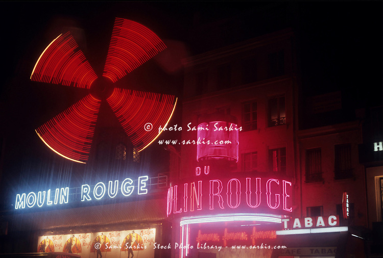 Illuminated neon signs of the Moulin Rouge, Quartier Pigalle, Paris, France.