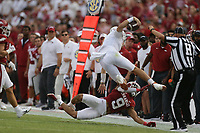 Arkansas defensive back Greg Brooks Jr. (9) stops Texas quarterback Hudson Card (1), Saturday, September 11, 2021 during the first quarter of a football game at Reynolds Razorback Stadium in Fayetteville. Check out nwaonline.com/210912Daily/ for today's photo gallery. <br /> (NWA Democrat-Gazette/Charlie Kaijo)