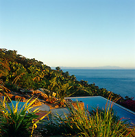 A glimpse of the jungle next to the infinity pool with a scenic view out towards the Pacific.