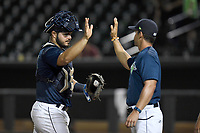 Catcher Brandon Brosher (25) of the Columbia Fireflies high-fives manager Jose Leger after a game against the Charleston RiverDogs on Monday, August 7, 2017, at Spirit Communications Park in Columbia, South Carolina. Columbia won, 6-4. (Tom Priddy/Four Seam Images)