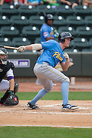 Jacob Rogers (27) of the Myrtle Beach Pelicans follows through on his swing against the Winston-Salem Dash at BB&T Ballpark on May 10, 2015 in Winston-Salem, North Carolina.  The Pelicans defeated the Dash 4-3.  (Brian Westerholt/Four Seam Images)